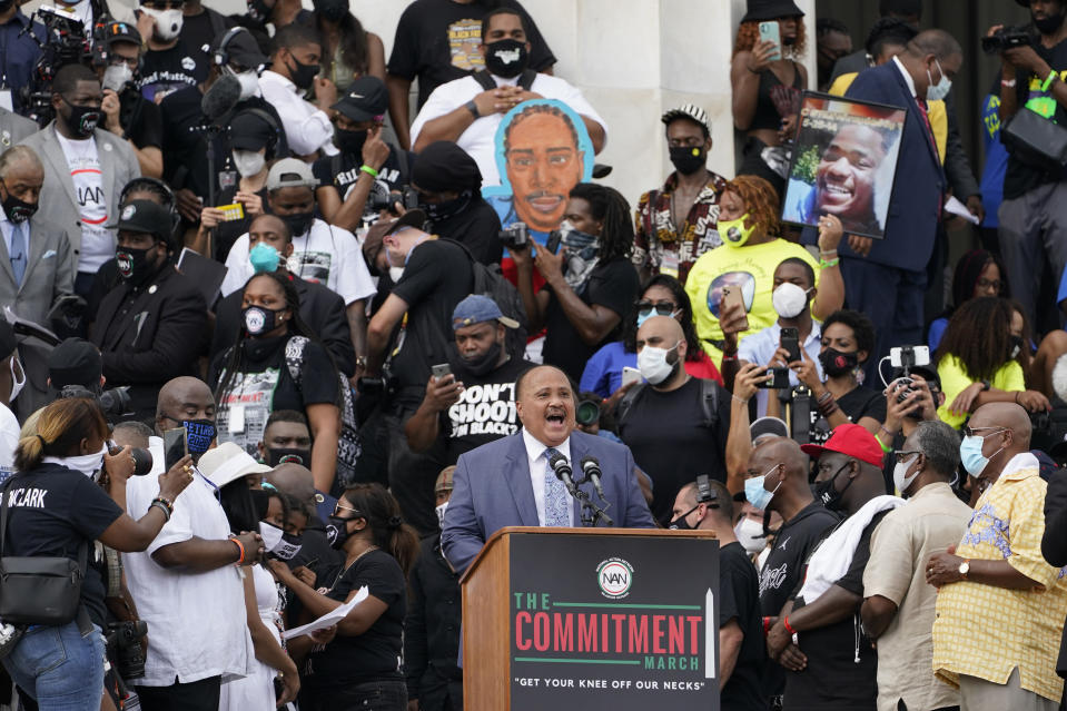 """FILE - In this Aug. 28, 2020, file photo, Martin Luther King, III speaks at the March on Washington, Friday Aug. 28, 2020, at the Lincoln Memorial in Washington, on the 57th anniversary of the Rev. Martin Luther King Jr.'s """"I Have A Dream"""" speech in Washington. A tough road lies ahead for Biden who will need to chart a path forward to unite a bitterly divided nation and address America's fraught history of racism that manifested this year through the convergence of three national crises. (AP Photo/Susan Walsh, File)"""