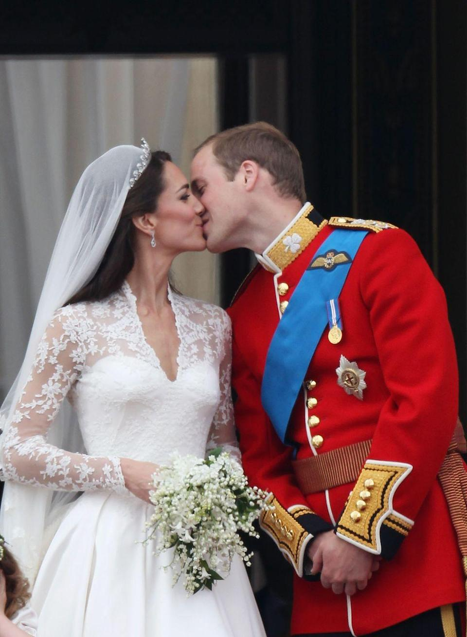 <p>The Duke and Duchess of Cambridge had not one but two kisses on their wedding day. Here they are smooching on the balcony of Buckingham Palace in front of their fans, April 2011.</p>