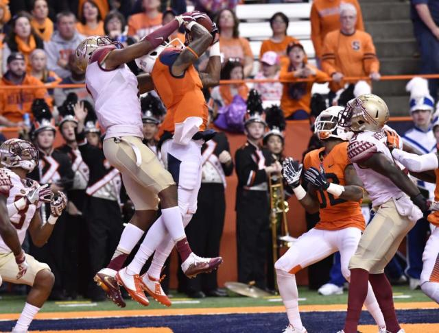 Nov 19, 2016; Syracuse, NY, USA; Syracuse Orange wide receiver Amba Etta-Tawo catches a Hail-Mary pass for a touchdown in front of Florida State Seminoles defensive back Ermon Laneat the end of the second quarter at the Carrier Dome. Mandatory Credit: Mark Konezny-USA TODAY Sports