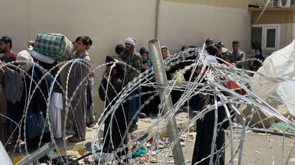 Afghanistan: Women throw babies over fence to