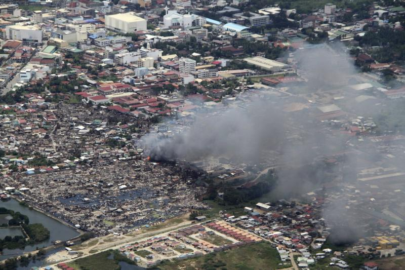 Philippine Air Force handout shows aerial view of smoke billowing from site of clashes between government troops and Muslim rebels of MNLF in a residential village in Zamboanga city