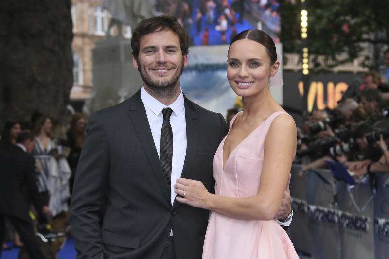 Sam Claflin and Laura Haddock pose for photographers upon arrival at the premiere of the film 'Transformers The Last Knight' in London, Sunday, June 18, 2017. (Photo by Joel Ryan/Invision/AP)