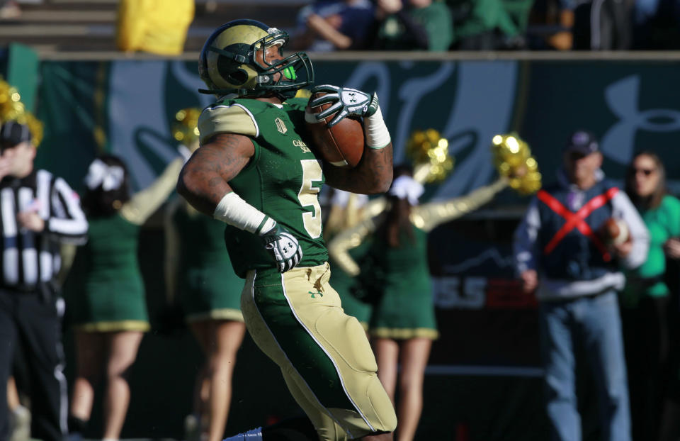 Colorado State running back Kapri Bibbs runs for a 1-yard touchdown against Air Force in the first quarter of an NCAA football game in Fort Collins, Colo., on Saturday, Nov. 30, 2013. (AP Photo/David Zalubowski)