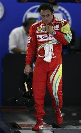 Ferrari Formula One driver Felipe Massa of Brazil reacts after having his weight taken after the qualifying session of the Brazilian F1 Grand Prix at the Interlagos circuit in Sao Paulo November 23, 2013. REUTERS/Paulo Whitaker