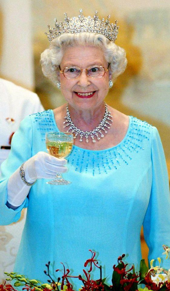 <p>Raising her glass, Her Majesty makes a toast during a state banquet at the Presidential Palace, Singapore. (Gareth Fuller/PA) </p>