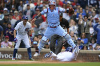 Chicago Cubs' Willson Contreras, bottom, slides safely into home plate on an Ian Happ single as St. Louis Cardinals catcher Yadier Molina, top, makes the catch during the third inning of a baseball game Saturday, Sept. 25, 2021, in Chicago. (AP Photo/Paul Beaty)