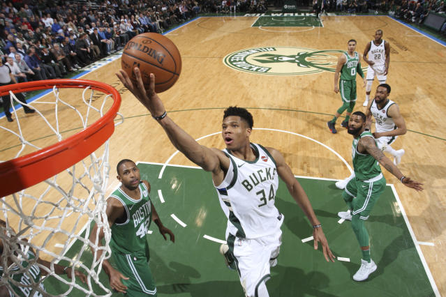 MILWAUKEE, WI - APRIL 3: Giannis Antetokounmpo #34 of the Milwaukee Bucks shoots the ball against the Boston Celtics on April 3, 2018 at the BMO Harris Bradley Center in Milwaukee, Wisconsin. (Photo by Gary Dineen/NBAE via Getty Images)