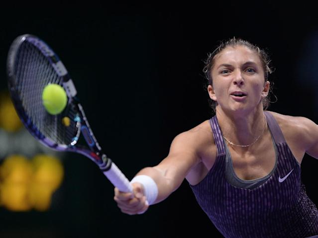 Sara Errani of Italy returns a shot to Li Na of China during their tennis match at the WTA championship in Istanbul, Turkey, Wednesday, Oct. 23, 2013. The world's top female tennis players compete in the championships which runs from Oct. 22 until Oct. 27. (AP Photo)