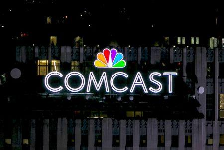 The NBC and Comcast logo are displayed on top of 30 Rockefeller Plaza formerly known as the GE building in midtown Manhattan in New York