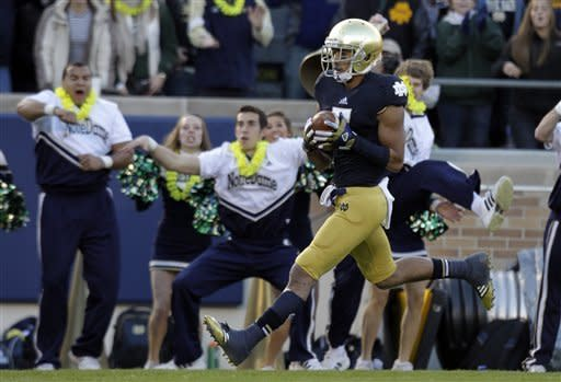 Notre Dame wide receiver TJ Jones scores a pass from quarterback Everett Golson against Wake Forest during the first half of an NCAA college football game in South Bend, Ind., Saturday, Nov. 17, 2012. (AP Photo/Michael Conroy)
