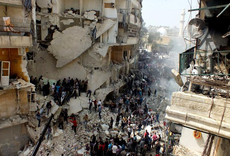 AP10ThingsToSee - This citizen journalism image taken on Sunday, April 7, 2013 and provided by Aleppo Media Center AMC which has been authenticated based on its contents and other AP reporting, shows Syrian citizens searching for bodies in the rubble of damaged buildings that were attacked by Syrian forces airstrikes, in the al-Ansari neighborhood of Aleppo, Syria. More than 70,000 people have died since Syria's crisis erupted in March 2011. The Syria-based Violations Documentation Center says nearly 9,000 government troops have been killed in two years of fighting between President Bashar Assad's forces and rebels trying to topple him. (AP Photo/Aleppo Media Center AMC, File)