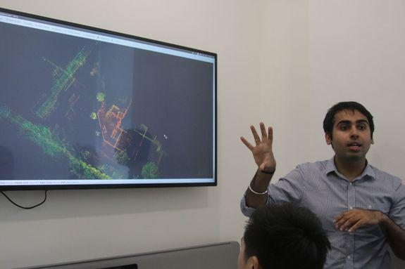 An Otsaw employee demonstrates the O-R3's 3D mapping abilities. The O-R3 can create 3D maps from its LIDAR sensors.