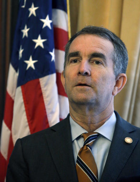 Gov. Ralph Northam prepares to adress a press conference at the State Capitol Monday, Jan. 6, 2020 where he previewed his voting legislative proposals, including removing Lee-Jackson Day as a state holiday and replacing it with election day. (Bob Brown/Richmond Times-Dispatch via AP)