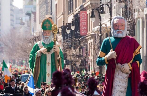 A giant effigy of St. Patrick is pulled along a street during the 2017 edition of the St. Patrick's Day parade in Montreal.  (Graham Hughes/The Canadian Press - image credit)