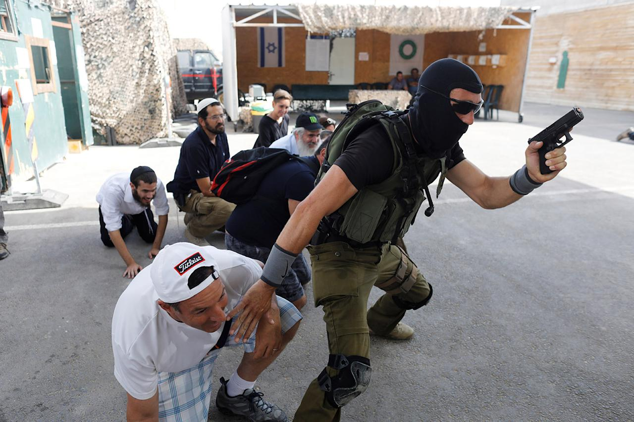 "<p>A group of tourists take part in a two hour ""boot camp"" experience, at ""Caliber 3 Israeli Counter Terror and Security Academy "" in the Gush Etzion settlement bloc south of Jerusalem in the occupied West Bank July 13, 2017. (Photo: Nir Elias/Reuters) </p>"
