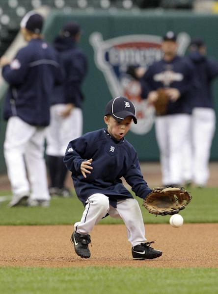 Gage Brookens, grandson of Detroit Tigers first base coach Tom Brookens, goes after a ground ball during a baseball workout at Comerica Park in Detroit, Friday, Oct. 26, 2012. The Tigers host the San Francisco Giants in Game 3 of baseball's World Series on Saturday. The Giants lead the best-of-seven games series 2-0. (AP Photo/Patrick Semansky)