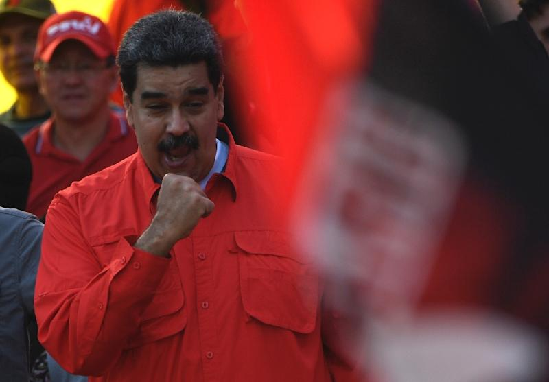 "Venezuelan President Nicolas Maduro, who said there was ""joy"" in the streets, gestures during a May Day rally in Caracas (AFP Photo/Juan BARRETO)"