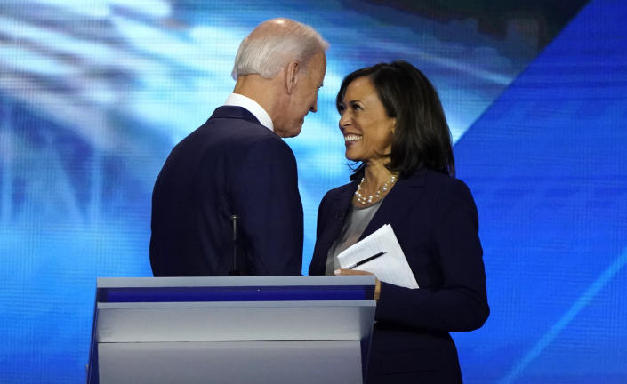 Former Vice President Joe Biden talks with Sen. Kamala Harris after the conclusion of a Democratic debate in Houston, Sept. 12, 2019. (Mike Blake/Reuters)