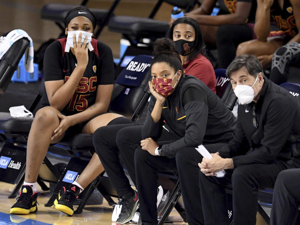 The Southern California bench looks on as UCLA defeats them in an NCAA college basketball game at Pauley Pavilion in Westwood, Calif., Friday, Feb. 26, 2021. (Keith Birmingham/The Orange County Register via AP)