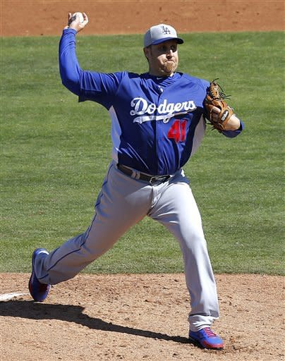 Los Angeles Dodgers' Aaron Harang delivers a pitch against the Chicago Cubs during the first inning of an exhibition spring training baseball game, Wednesday, Feb. 27, 2013, in Mesa, Ariz. (AP Photo/Matt York)