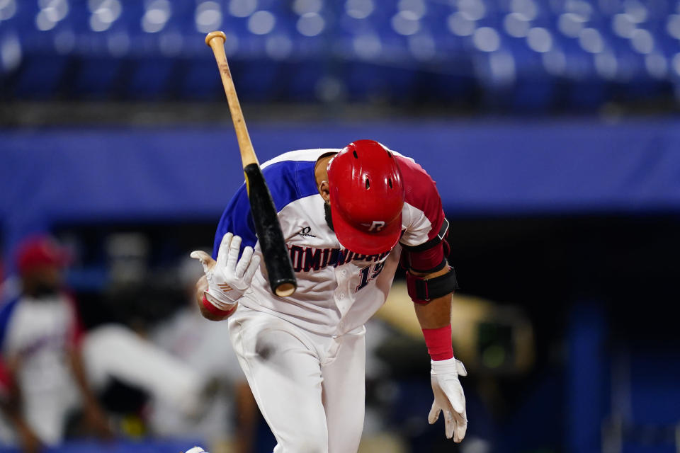 Dominican Republic's Jose Bautista tosses his bat after hitting a game winning RBI single during a baseball game against Israel at the 2020 Summer Olympics, Tuesday, Aug. 3, 2021, in Yokohama, Japan. The Dominican Republic won 7-6. (AP Photo/Matt Slocum)