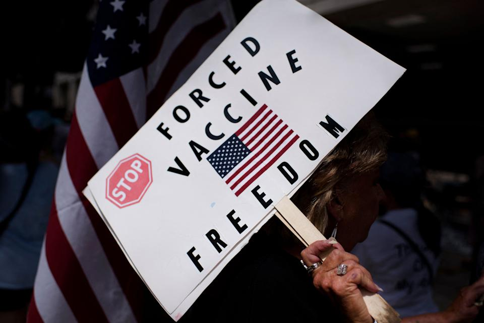 Anti-vaccine rally protesters hold signs outside of Houston Methodist Hospital in Houston, Texas, on June 26, 2021. (Mark Felix/AFP via Getty Images)