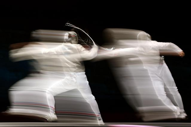 Aron Szilagyi (L) of Hungary competes against Nikolay Kovalev of Russia during their Men's Sabre Individual semifinal match on Day 2 of the London 2012 Olympic Games at ExCeL on July 29, 2012 in London, England. (Photo by Quinn Rooney/Getty Images)