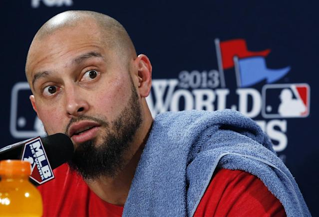 Boston Red Sox's Shane Victorino answers a question during a news conference before Game 6 of baseball's World Series against the St. Louis Cardinals Wednesday, Oct. 30, 2013, in Boston. (AP Photo/Elise Amendola)