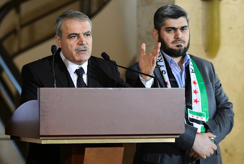 High Negotiations Committee Chairman Asaad al-Zoabi (L) and chief negotiator Mohammed Alloush attend a press briefing on March 22, 2016 in Geneva (AFP Photo/Fabrice Coffrini)