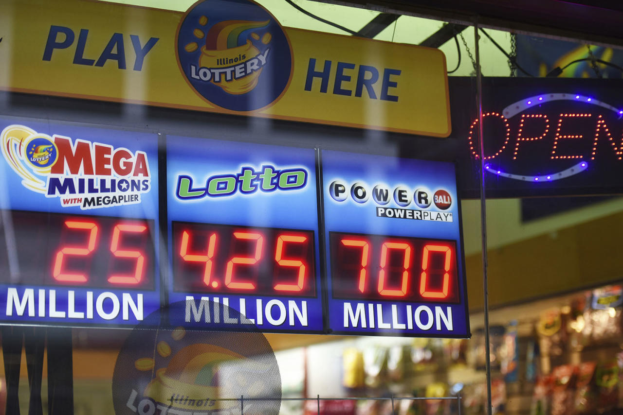 <p>Signs display the lottery prizes, Aug. 22, 2017, in Chicago. Officials estimated jackpot for Wednesday night's Powerball lottery game has climbed to $700 million, making it the second largest in U.S. history. (Photo: G-Jun Yam/AP) </p>
