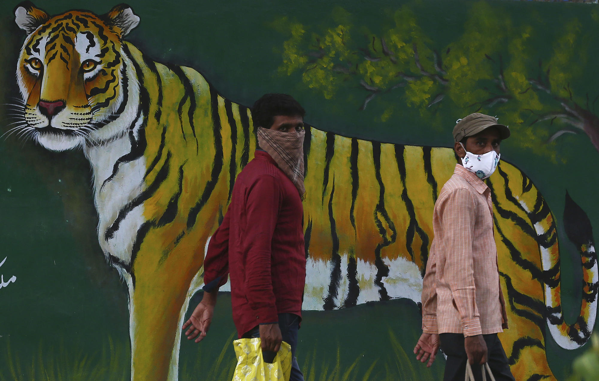 Image The Latest: India sees cases drop, struggles on vaccinating