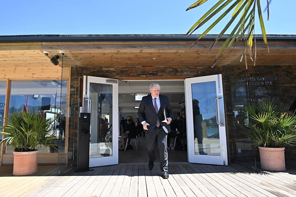 Johnson leaves after a press conference on the final day of the summit in Cornwall (PA)