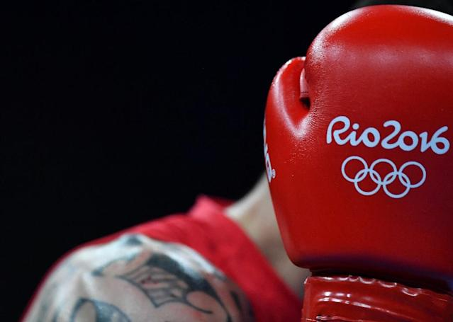 The International Olympic Committee has frozen boxing's preparations for Tokyo as it seeks proof the International Boxing Federation has cleaned up its act sufficiently after allegations of bout-fixing at the 2016 Rio Olympics (AFP Photo/Yuri CORTEZ )