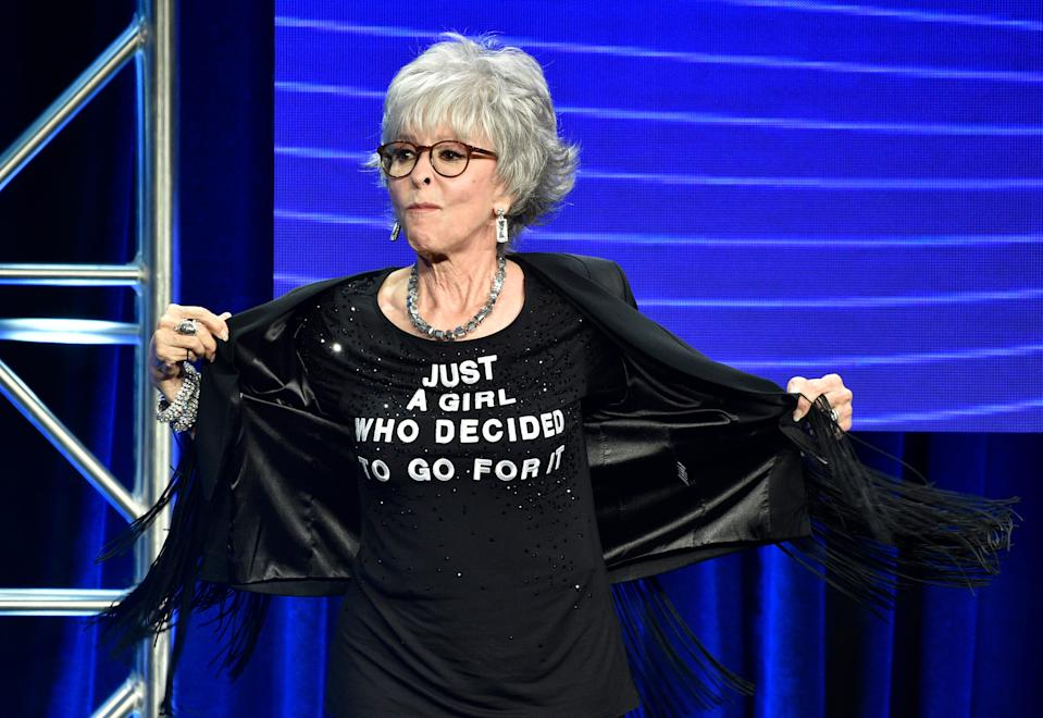 Rita Moreno shows off her T-shirt onstage during the 2018 Television Critics Association Summer Press Tour.