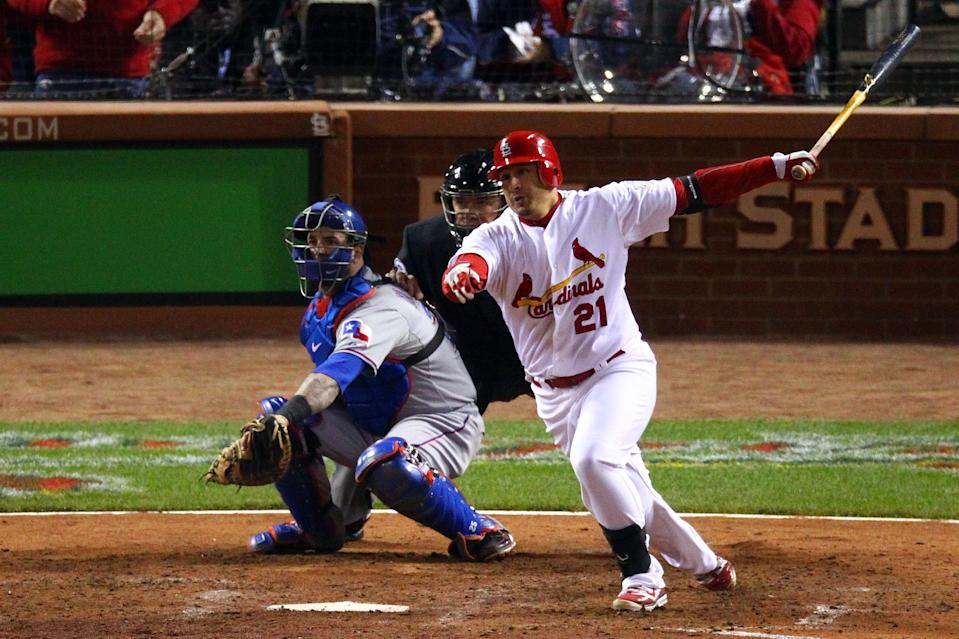 ST LOUIS, MO - OCTOBER 20: Allen Craig #21 of the St. Louis Cardinals hits an RBI single in the seventh inning off of Alexi Ogando #41 of the Texas Rangers during Game Two of the MLB World Series at Busch Stadium on October 20, 2011 in St Louis, Missouri. (Photo by Dilip Vishwanat/Getty Images)