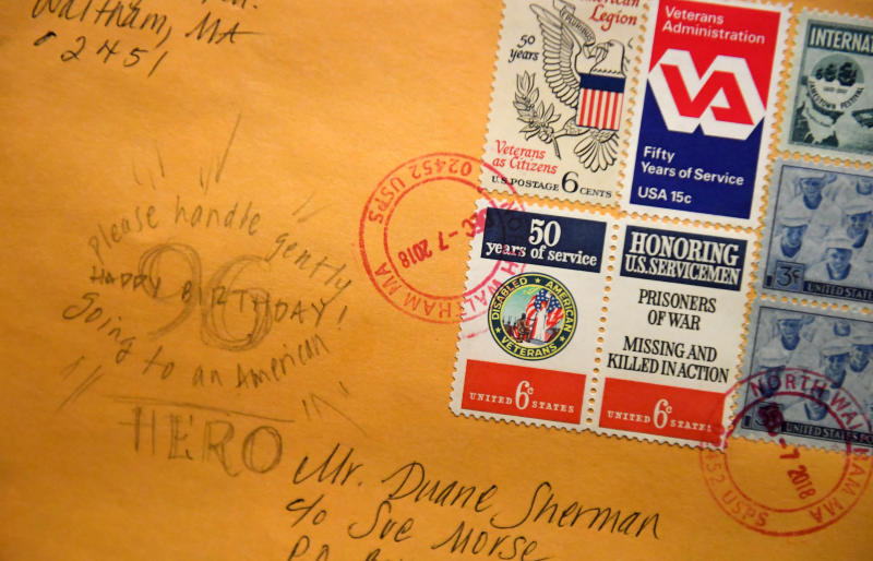 "In this Tuesday, Jan. 8, 2019 photo, a handwritten note on one of the 50,000 birthday cards received by Duane Sherman, 96, reads ""Please handle gently, going to an American Hero"" displayed at his home in Fullerton, Calif. (Kevin Sullivan/The Orange County Register via AP)"