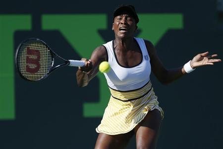 Mar 23, 2014; Miami, FL, USA; Venus Williams hits a forehand against Casey Dellacqua (not pictured) on day seven of the Sony Open at Crandon Tennis Center. Mandatory Credit: Geoff Burke-USA TODAY Sports - RTR3I9U6