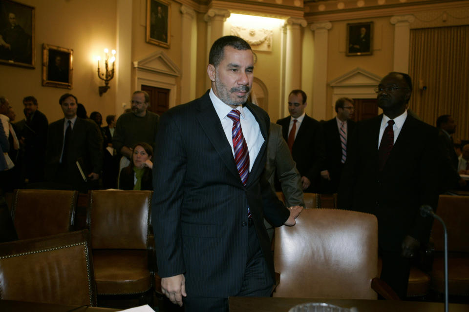 "New York Governor David Paterson takes his seat before the U.S. House Ways and Means Committee hearing on economic recovery and job creation options on Capitol Hill in Washington October 29, 2008. Paterson said on Wednesday the U.S. Congress must pass a stimulus bill that includes ""direct and immediate fiscal relief"" for states such as emergency block grants.   REUTERS/Mitch Dumke  (UNITED STATES)"