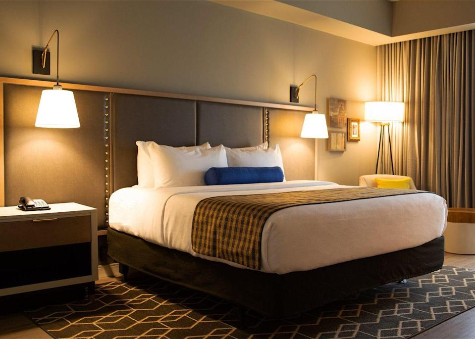 <p><strong>Why did this hotel catch your attention?</strong> Outside of the major cities, finding hotels with character can be a challenge in the south, so this relatively new property from IHG's Indigo brand is a welcome addition to Hub City's accommodation portfolio. Real thought has gone into incorporating the neighborhood's history into the design, the interior celebrating a specifically industrial past. Timber trade and railroad elements are here; you'll notice especially in the train tunnel lighting fixtures and fabrics that recall vintage conductor uniforms. It's a chain hotel with a boutique feel.</p> <p><strong>What's the backstory?</strong> The 100-room hotel opened in 2018 and is the only Indigo-branded hotel in the state of Mississippi. Despite being an IHG hotel, the Indigo's design team worked hard to avoid the property just being another cookie-cutter hotel, with consciously appropriate design choices and a customization of the usual template to reflect the history of the neighborhood.</p> <p><strong>Tell us all about the accommodations. Any tips on what to book?</strong> The rooms are notably fresh and feel elevated above their chain hotel peers in the area. My King Executive was typical, the wooden floors and studded bed frame paying homage to the industrial theme. Fixtures and fittings aren't overly fussy and retain a minimalist, contemporary feel, the overall neutral tones of the decor enlivened with a few pops of primary color from cushions and the like. The bathroom incorporated a striking monochromatic tiling pattern and Aveda products reinforced the affordable luxe ethos.</p> <p><strong>Drinking and dining—what are we looking at?</strong> There's a charming 1930s railroad theme to the hotel's onsite restaurant, Brass Hat, with lots of exposed brickwork and reclaimed materials maintaining the design motifs of the guest rooms and the public spaces. The restaurant serves up a good selection of popular small plates, sandwiches and larger entrees t