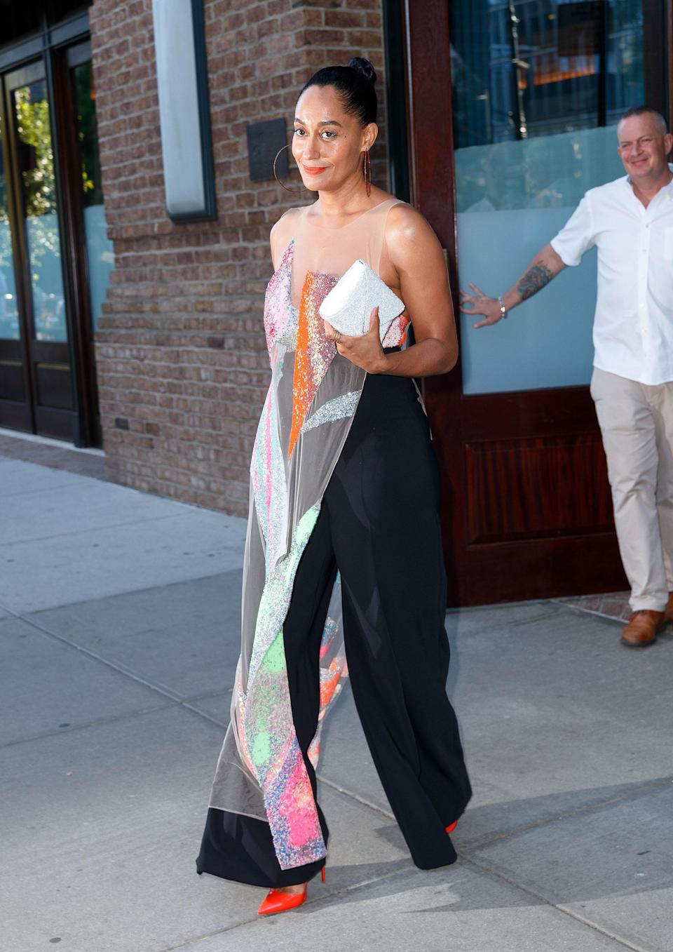 <p>The actress nailed it in the style stakes once more, wearing a sheer overlay gown by Germanier which she wore with high-waisted black trousers and a pair of orange pumps by Christian Louboutin to the ACE awards.<br><em>[Photo: Getty]</em> </p>