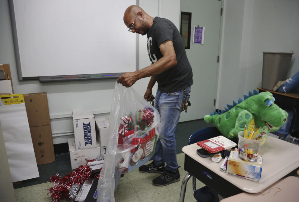Charles Fabian, facilities manager at Queen of the Rosary Catholic Academy, sorts through classroom materials that can be donated, Thursday, Aug. 6, 2020, in Brooklyn borough of New York. In July the Archdiocese of Brooklyn and Queens announced that six Catholic schools in the two boroughs will close permanently at the end of August due to debt and low enrollment aggravated by the coronavirus pandemic. (AP Photo/Jessie Wardarski)