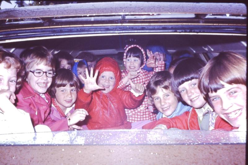 Heidi sits center, in the red hooded coat. Her little sister is next to her, wearing the gingham coat. Her older sister is second from the far right. (Courtesy of Heidi Legg)