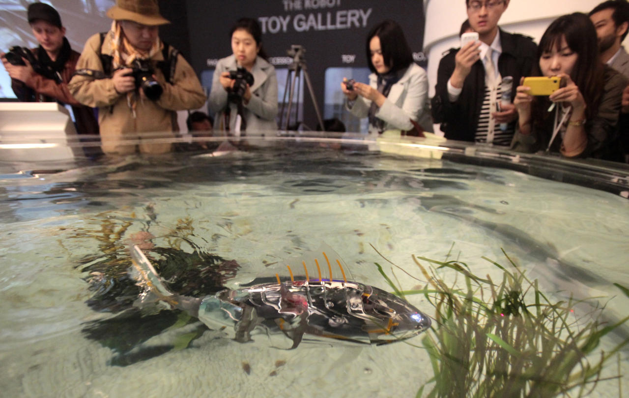 "FILE - In this Friday, April 20, 2012 file photo, a fish robot swims at the Marine Robot Pavilion of the EXPO 2012 in Yeosu, South Korea. The Expo 2012 will open for three months on May 12 in Yeosu with a theme focused on the ocean. Its formal theme is ""The Living Ocean and Coast: Diversity of Resources and Sustainable Activities."" (AP Photo/Ahn Young-joon, File)"