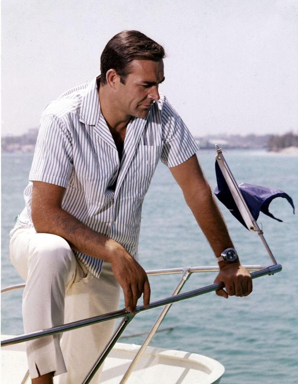 <p>Sean Connery leans over the bow of a small motorboat in 1970. </p>
