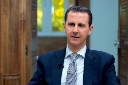 Syria's President Bashar al-Assad speaks during an interview with AFP news agency in Damascus