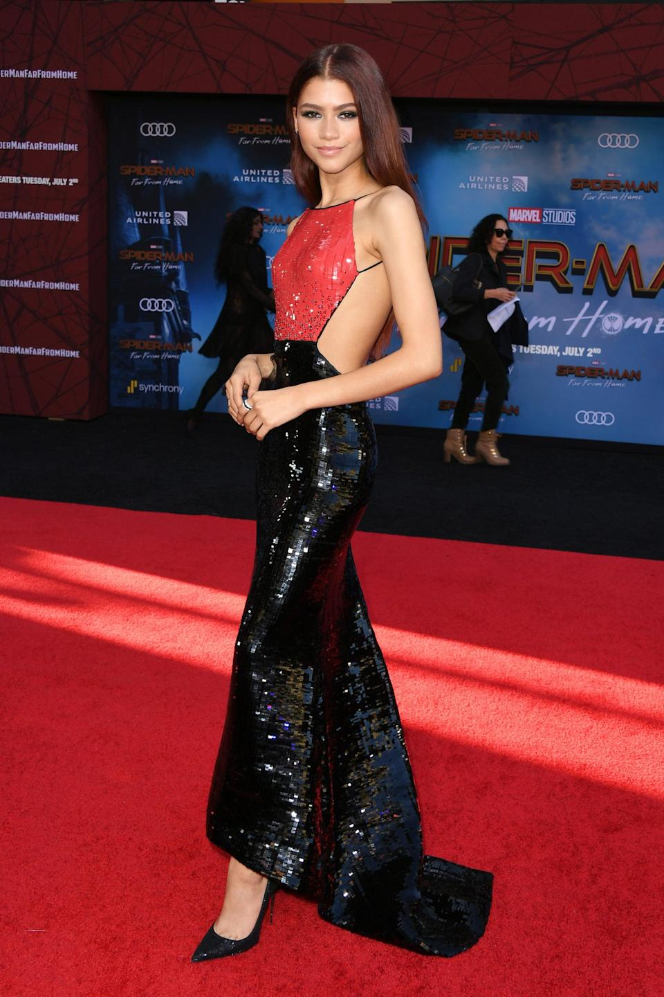 """<p><a class=""""link rapid-noclick-resp"""" href=""""https://www.popsugar.co.uk/Zendaya"""" rel=""""nofollow noopener"""" target=""""_blank"""" data-ylk=""""slk:Zendaya"""">Zendaya</a> <a href=""""https://www.popsugar.com/fashion/Zendaya-Armani-Prive-Dress-Spider-Man-Premiere-46323195"""" class=""""link rapid-noclick-resp"""" rel=""""nofollow noopener"""" target=""""_blank"""" data-ylk=""""slk:wore a sequin Armani Privé dress"""">wore a sequin Armani Privé dress</a> to the <strong>Spider-Man: Far From Home</strong> premiere in 2019. And yes, the red and black motif was <a href=""""https://www.etonline.com/zendaya-says-shes-having-a-pinch-me-moment-at-spider-man-far-from-home-premiere-exclusive-127763"""" class=""""link rapid-noclick-resp"""" rel=""""nofollow noopener"""" target=""""_blank"""" data-ylk=""""slk:meant to resemble"""">meant to resemble</a> the superhero's newly revamped suit in the sequel, shown below. """"This was our homage to the <strong>Far From Home</strong> suit that he wears,"""" <a class=""""link rapid-noclick-resp"""" href=""""https://www.popsugar.co.uk/Zendaya"""" rel=""""nofollow noopener"""" target=""""_blank"""" data-ylk=""""slk:Zendaya"""">Zendaya</a> told <strong>Entertainment Tonight</strong> on the red carpet. """"This is my own version.""""</p>"""