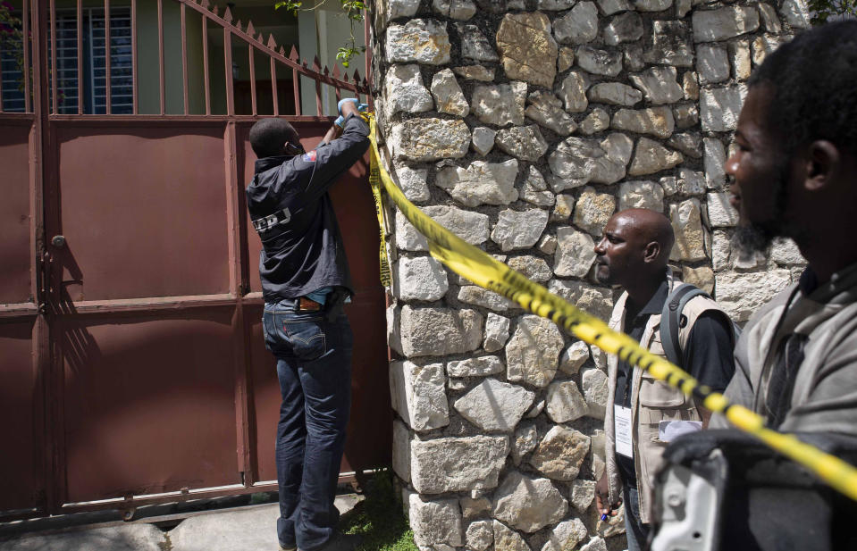 A member of security forces cordons off access to the residence of Haitian President Jovenel Moise, in Port-au-Prince, Haiti, Wednesday, July 7, 2021. Gunmen assassinated Moise and wounded his wife in their home early Wednesday. (AP Photo/Joseph Odelyn)