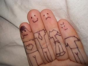 People drawn on fingers of one hand