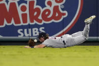 Houston Astros center fielder Jake Meyers attempts to make a catch on a ball hit by Los Angeles Angels' Brandon Marsh during the third inning of a baseball game Wednesday, Sept. 22, 2021, in Anaheim, Calif. Marsh was safe at first on the play. (AP Photo/Mark J. Terrill)
