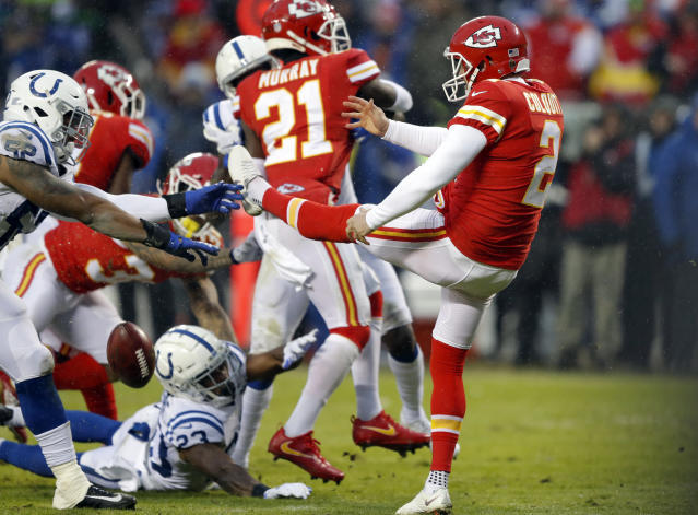 Indianapolis Colts linebacker Najee Goode (52) blocks a punt by Kansas City Chiefs punter Dustin Colquitt in the first half of Saturday's AFC divisional round game. (AP)